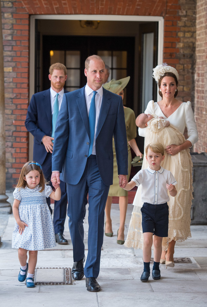 The royal family at the Christening of Prince Louis. Note the classic replica of the royal family gown on Prince Louis.
