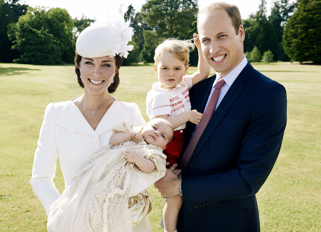 The royal family at the christening of Princess Charlotte. Again note the replica of the classic family gown on Princess Charlotte, and the familiar outfit on Prince George.