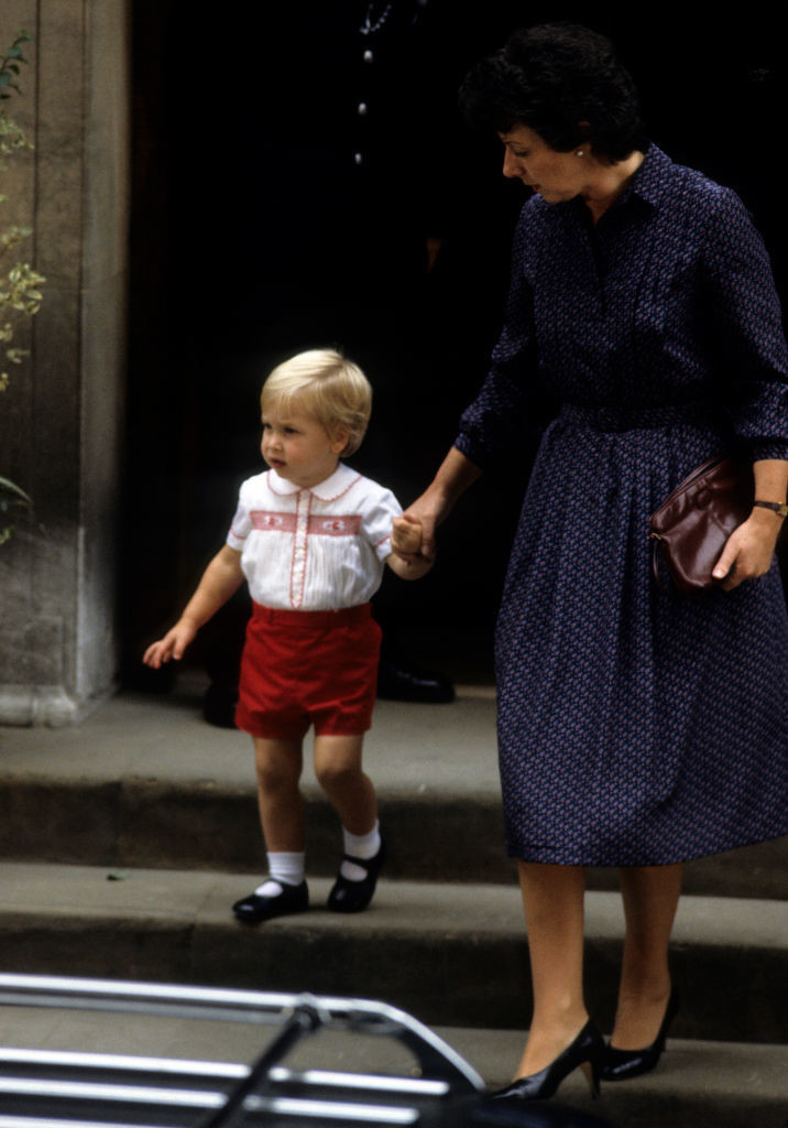 Prince William, 2, on the steps of the Lindo Wing of St. Mary's hospital, (where his own children would be born years later). He had just met his new baby brother, Prince Harry in 1984.
